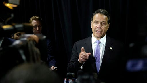 New York Governor Andrew Cuomo speaks to reporters after a news conference in a MTA bus depot in New York, Tuesday, May 17, 2016.