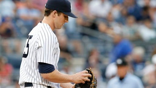 New York Yankees relief pitcher Bryan Mitchell (55) reacts during the 11th inning of the Yankees 9-5 loss to the Toronto Blue Jays in the first baseball game of a doubleheader at Yankee Stadium in New York, Saturday, Sept. 12, 2015.