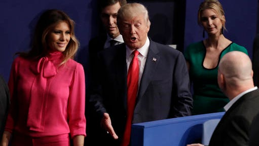 Republican presidential nominee Donald Trump walks out with his wife Melania Trump and daughter Ivanka following the second presidential debate with Democratic presidential nominee Hillary Clinton at Washington University in St. Louis, Sunday, Oct. 9, 2016.  (AP Photo/John Locher)