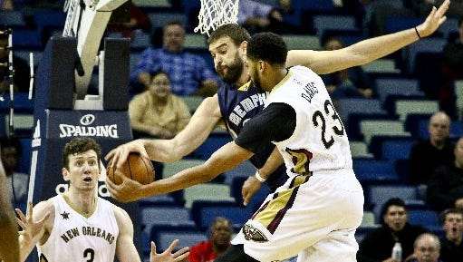 Memphis Grizzlies center Marc Gasol (33) deflects a pass by New Orleans Pelicans forward Anthony Davis (23) to center Omer Asik (3) during the first quarter at the Smoothie King Center.