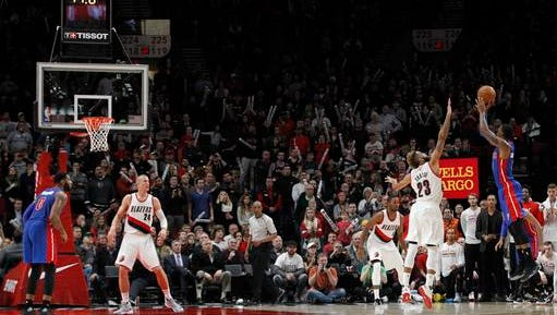 Detroit Pistons guard Kentavious Caldwell-Pope, right, takes the game-winning shot over Portland Trail Blazers guard Allen Crabbe during the second overtime of an NBA basketball game in Portland, Ore., Sunday, Jan. 8, 2017. (AP Photo/Steve Dipaola)
