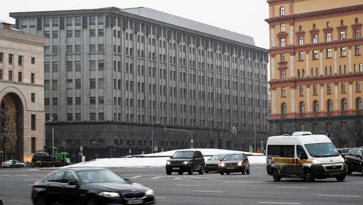 FILE - In this Friday, Dec. 30, 2016 file photo FSB headquarters, grey building at center, in downtown Moscow, Russia. Moscow has been awash with rumours of a hacking-linked espionage plot at the highest level since cyber-security firm Kaspersky said one of its executives with ties to the Russian intelligence services had been arrested on treason charges.