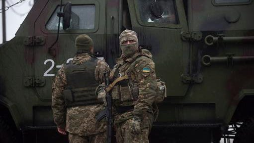 Ukrainian servicemen patrol near the humanitarian aid center in Avdiivka, Ukraine, Saturday, Feb. 4, 2017. Fighting in eastern Ukraine sharply escalated this week. Ukraine's military said several soldiers were killed over the past day in shelling in eastern Ukraine, where fighting has escalated over the past week.