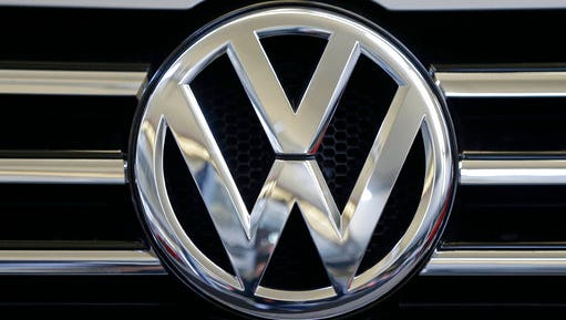 FILE - This Feb. 14, 2013, file photo, shows the logo on the grill of a Volkswagen on display in Pittsburgh. On Friday, March 10, 2017, Volkswagen is expected to plead guilty to three criminal counts at a morning hearing in Detroit federal court for cheating on diesel emissions tests.