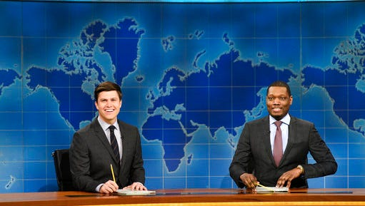 "In this March 4, 2017 photo provided by NBC, Colin Jost and Michael Che, right, appear during Weekend Update segment of ""Saturday Night Live"" in New York. ""Saturday Night Live"" gets the summer off but ""Weekend Update"" will keep the political satire coming in prime-time. NBC said Tuesday, March 14, 2017, that four episodes of ""Saturday Night Live: Weekend Update"" will air at 9 p.m. Thursday starting Aug. 10 ."