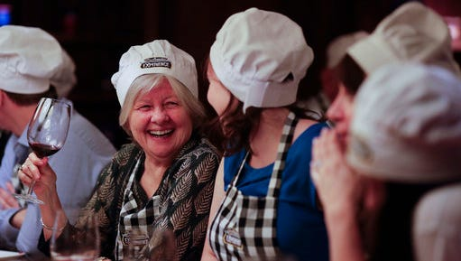 """In this March 20, 2017 photo Katherine O'Connor, from Toronto, smiles during an activity called """"The Argentine Experience"""" in Buenos Aires, Argentina. Tourists participating in """"The Argentine Experience"""" have the chance to learn about the local cuisine, wine and traditions during a dinner in Buenos Aires."""