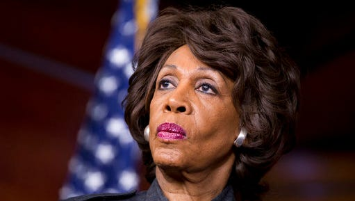 FILE - In this Feb. 28, 2013 file photo, Rep. Maxine Waters, D-Calif., listens during a news conference on Capitol in Washington. Waters has served in Congress for a quarter-century. Now she's turned into the passionate voice of resistance against the Trump administration.