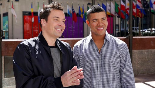 """In this Tuesday, April 18, 2017 photo provided by NBC, host Jimmy Fallon, left, speaks Spanish with Jose Quintana on """"The Tonight Show Starring Jimmy Fallon,"""" in New York. Quintana returned a big favor to Fallon on Tuesday night. The Chicago White Sox left-hander appeared on the show, teaching the late-night host a few Spanish phrases - some more useful than others - as a thank you for Fallon's role in Quintana picking up English."""