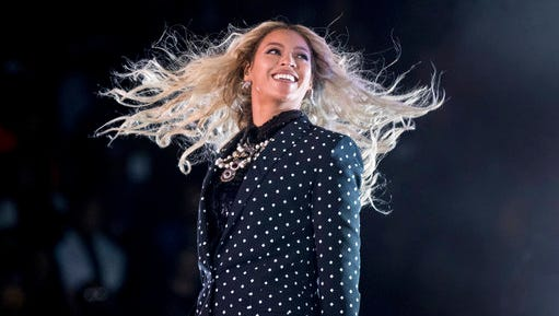 """FILE - In this Nov. 4, 2016, file photo, Beyonce performs at a Get Out the Vote concert for Democratic presidential candidate Hillary Clinton at the Wolstein Center in Cleveland. Beyonce marked the one-year anniversary of her album """"Lemonade"""" on April 25, 2017, by announcing scholarships for women to attended selected colleges."""