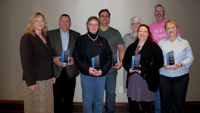 2015 Award Winners from left: Amy Hansen, DFP executive director; Leo Metivier, Volunteer of Year; Kay Schustedt, Downtown Legacy Award; Ted Buetow, Design of the Year; Tracy Mathweg, Interior Renovation of the Year; Lisa Pauly, Friend of Downtown, Scott and Jeanie Page, Best New Downtown Business.