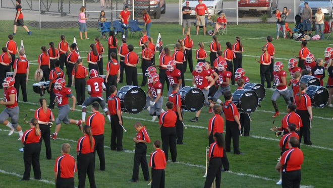 Port Huron takes the field at Memorial Stadium before its game against Warren Mott on Sept. 9, 2016.