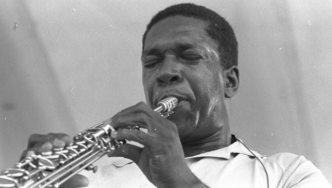 John Coltrane performs at the Newport Jazz Festival.