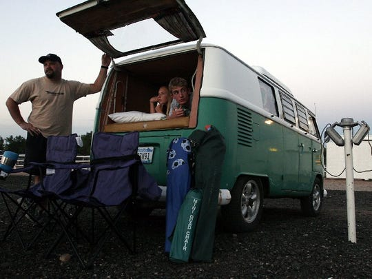 Mike Pribesh, his daughter Ciara, 13, and son Zach, 15, wait for a show to begin at the Holiday Twin Drive-In in 2004.