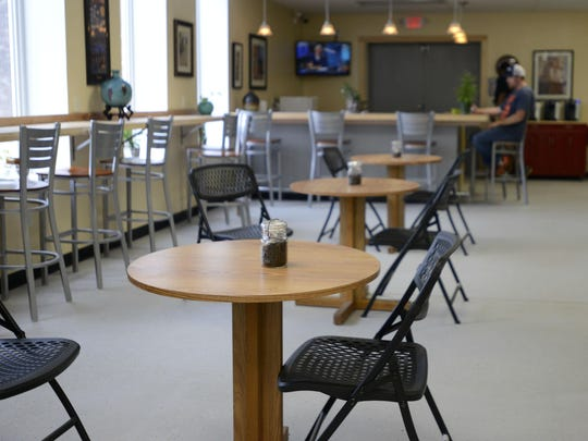 """Phillip Peterson of Colchester sits in the café area in Clothes Quarters Laundromat on Tuesday afternoon. Tuesday was Peterson's first time at the Winooski laundromat, which he described as the """"most unique"""" he's ever patronized."""
