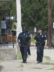Camden County Police officers walk on South 8th Street
