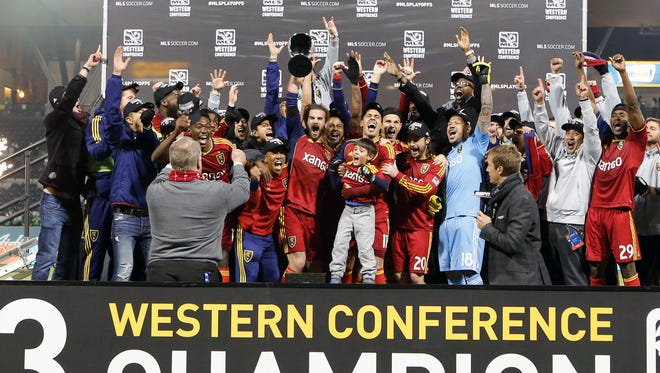 Real Salt Lake players lift the MLS Western Conference Championship trophy after defeating the Portland Timbers 5-2 on aggregate goals at Jeld-Wen Field.