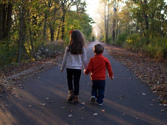 Kids walk on the Tallgrass Trail.