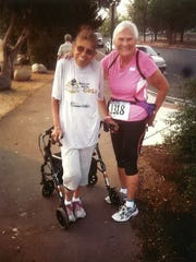 Margarita Barba, 64, left, did not allow her walker to prevent her from winning a gold medal last week in the one-mile walk race at Virginia Lake for women in the 60-64 age group. And Virginia Evans, 84, also won a gold medal in the women's walk race for the 80-84 age group in the 2015 Reno/Tahoe Senior Games.