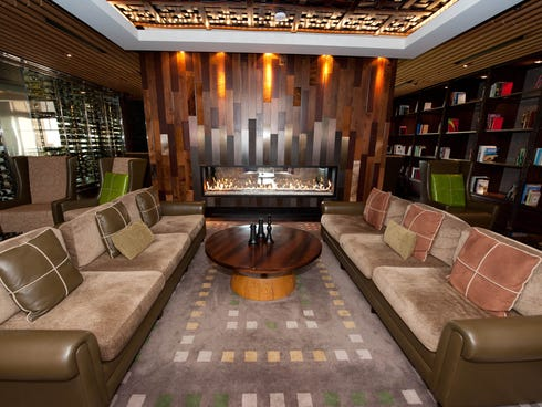 The Lobby Bar at the Viceroy Snowmass, Colorado: The two-sided fireplace is the highlight of this appealing lounge, which features local artwork and lots of wood accents. Comfort food with a southern twist is served, such as popcorn crawfish and okra