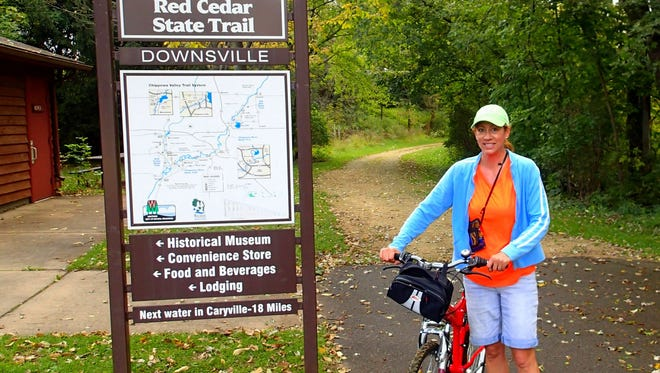 Barb Harris cycled the Red Cedar River trail south of Menominee on Saturday, Sept. 20, 2014.