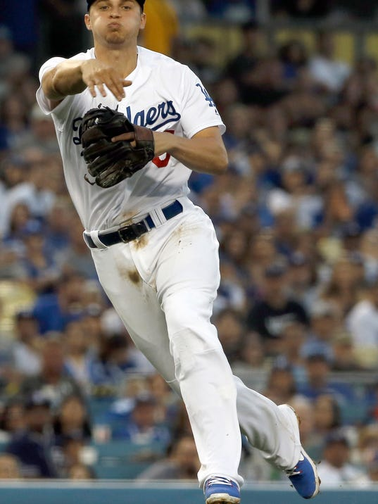 Los Angeles Dodgers shortstop Corey Seager throws out San Diego Padres' Austin Hedges at first base during the fourth inning of a baseball game in Los Angeles, Saturday, Aug. 12, 2017. (AP Photo/Alex Gallardo)