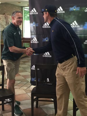 MSU coach Mark Dantonio shakes hands with Michigan coach Jim Harbaugh at the Sound Mind Sound Body camp Friday, June 10, 2016 at Wayne State University in Detroit.