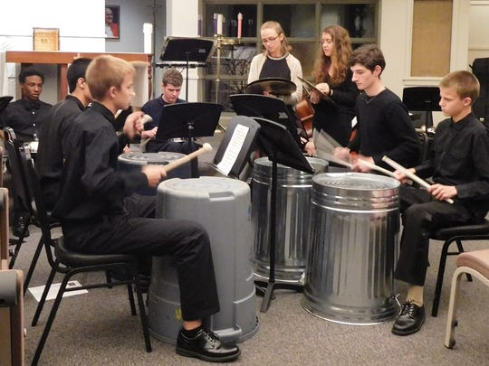JPII music students perform a percussion piece on unconventional
