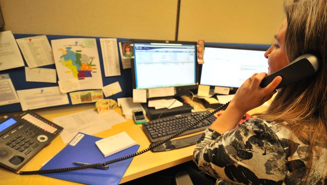 A community resource manager takes a call in 2014 at the United Way of Marathon County in Wausau.