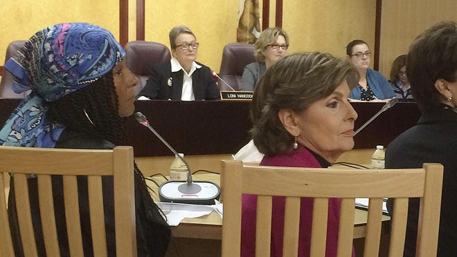 """FILE - In this April 12, 2016, file photo, Kelly Johnson, then referred to as """"Kacey,"""" front left, one of Bill Cosby's accusers, and attorney Gloria Allred, front right, attend a hearing at the State Capitol in Sacramento, Calif. Cosby is set to attend a Monday, March 5, 2018, pretrial hearing leading up to the entertainer's retrial on charges he drugged and sexually assaulted Andrea Constand at his home near Philadelphia. Prosecutors are seeking to call as many as 19 other accusers to the witness stand during the retrial, including Johnson. The Associated Press does not typically name people who say they are sexual assault victims, but Johnson, who previously used the pseudonym """"Kacey,"""" has spoken out publicly and was the only accuser besides plaintiff Andrea Constand allowed to testify at Cosby's first trial. (AP Photo/Don Thompson, File)"""
