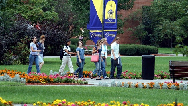 Students at Saint Michael's College in Colchester walk across campus.