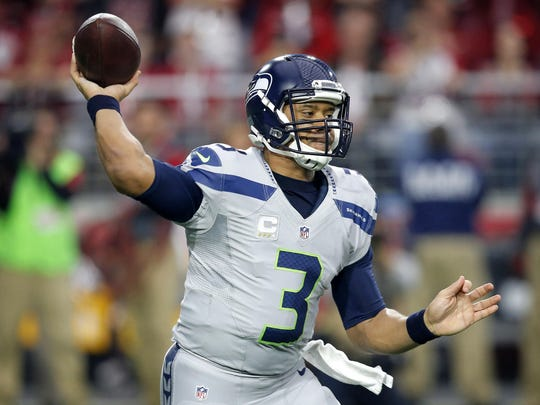Seattle Seahawks quarterback Russell Wilson throws