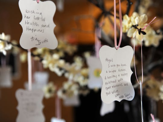 Best wishes hang on Abigail's tree at her baby shower in Salinas.