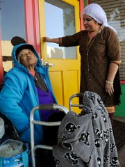 Epifania Dumpit, 82, left, talks to volunteer Rosa M. Barocio, 44, in front of Dorothy's Place. Barocio cooks the noon meal on the first Sunday of each month at Dorothy's Place.