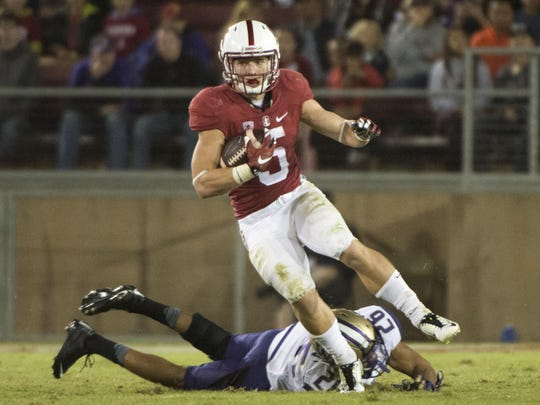 October 24, 2015; Stanford, CA, USA; Stanford Cardinal running back Christian McCaffrey (5) runs with the football against Washington Huskies defensive back Sidney Jones (26) during the third quarter at Stanford Stadium. The Cardinal defeated the Huskies 31-14. Mandatory Credit: Kyle Terada-USA TODAY Sports
