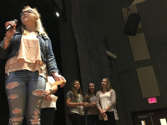"Junior Kiersten Siko speaks during the ""walkup"" event the morning of Wednesday, March 14 in James Buchanan High School's auditorium. Siko and several other students organized the event as an alternative to participating in the National School Walkout."