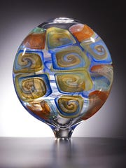 Work by glass blower Lino Tagliapietra is part of an exhibit at the Bergstrom-Mahler Museum of Glass in Neenah.