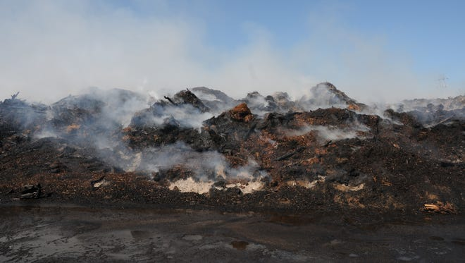 A compost pile at Brown's Island Demolition Landfill smolders Thursday morning.