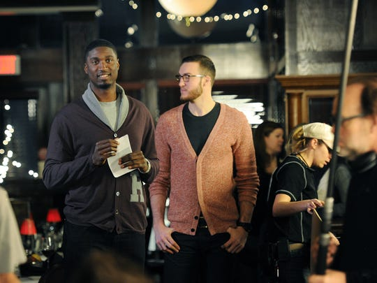 "Members of the ""Parks and Recreation"" production crew mill about Roy Hibbert and former Pacer Miles Plumlee at St. Elmo Steak House in December 2012."
