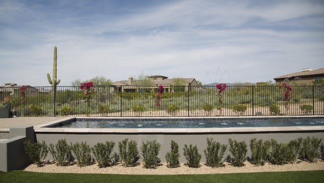 HGTV's smart home sits finished in Scottsdale on March 15, 2017. The smart home is part of a sweepstakes where contestants can win the home, a Mercedes SUV and $100,000. The home has several smart features that control lighting, blinds, toilets, showers, locks and security, among other features in the house.