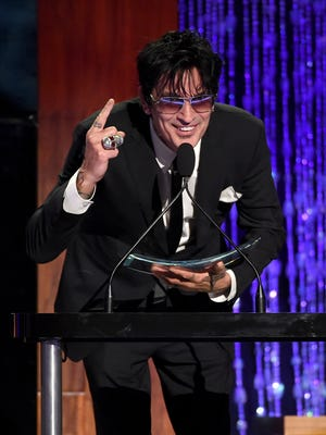 Motley Crue bass player Tommy Lee accepts the Skins award onstage at PETA's 35th Anniversary Party.