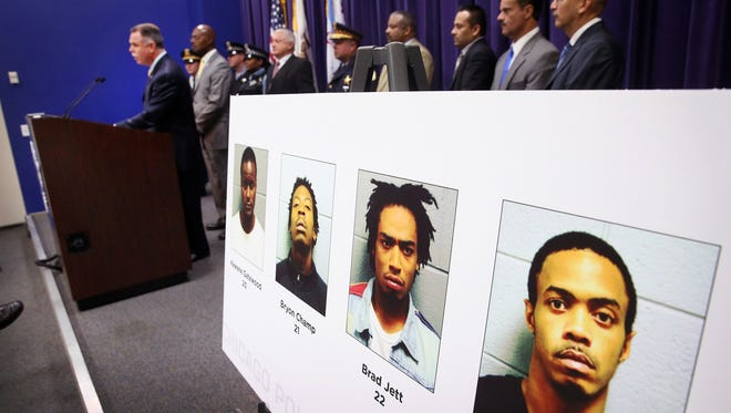Chicago Police Superintendent Garry McCarthy announces  Sept. 24,2013, the arrests of four suspects in a mass shooting at a park in Chicago's South side that left 13 people injured.