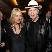 Neil Young and Pegi Young arrive at Clive Davis and the Recording Academy's 2012 Pre-GRAMMY Gala and Salute to Industry Icons Honoring Richard Branson held at The Beverly Hilton Hotel on February 11, 2012 in Beverly Hills, California.