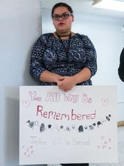 Vineland students Tanatian Sanchez holds a sign during