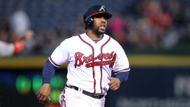 Alberto Callaspo runs to third against the Nationals at Turner Field.