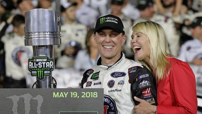 Kevin Harvick celebrates in Victory Lane with his wife, DeLana Harvick, after winning the NASCAR All-Star race at Charlotte Motor Speedway on Saturday.
