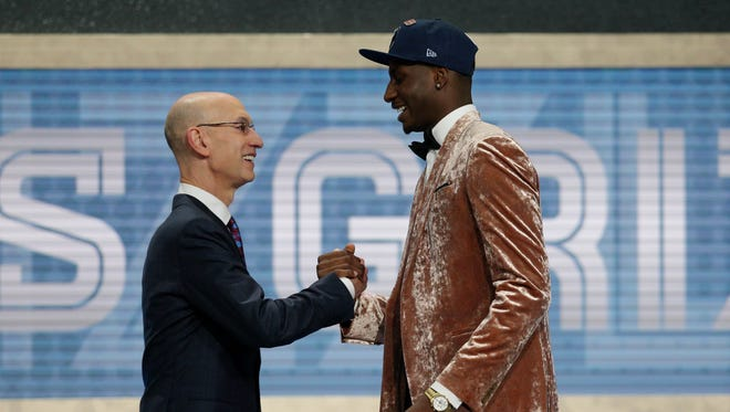 Jaren Jackson, Jr. (Michigan State) greets NBA commissioner Adam Silver after being selected as the number four overall pick to the Memphis Grizzlies in the first round of the 2018 NBA Draft at the Barclays Center.