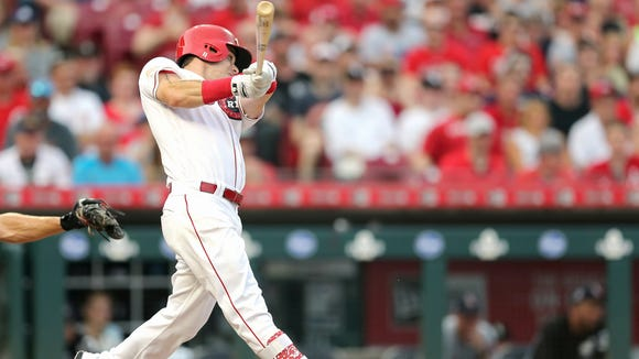 Cincinnati Reds second baseman Scooter Gennett (3) hits an RBI single in the fourth inning during an interleague baseball game between the Chicago White Sox and the Cincinnati Reds, Wednesday, July 4, 2018, at Great American Ball Park in Cincinnati.