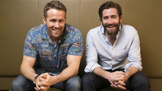 Ryan Reynolds, left, and Jake Gyllenhaal are real-life pals and co-stars in sci-fi movie 'Life,' opening Friday.