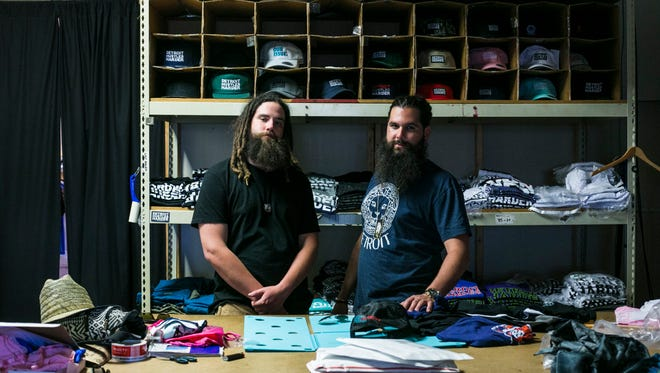 "Brendan Blumentritt, 30, left and Joseph ""JP"" O'Grady, 31, right, at their store, Detroit Hustles Harder, in Eastern Market on Wednesday, June 28, 2017. The apparel and lifestyle brand is celebrating its 10 year anniversary with a party at Marble Bar this weekend in Detroit. (Brittany Greeson, Special to the Free Press)"