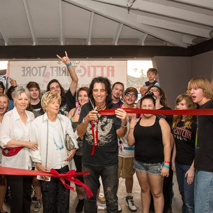Alice Cooper cuts ribbon on Alice's Attic, a thrift store he's opened in connection with his Rock Teen Center